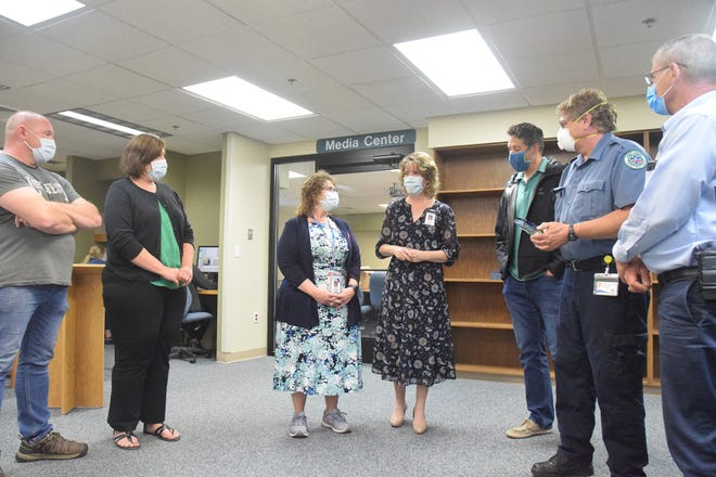 Jennifer Woods (center), chief nursing officer at McLaren Northern Michigan, addresses members of the hospital's stroke collaboration as (from left) Joe Loper, Barb Loper, stroke program coordinator Nicole Murray, Dr. Matthew Font, Emmet County EMS operations manager Calvin Penfold and Emmet County EMS director Randy Weston look on Wednesday at the hospital's media center.