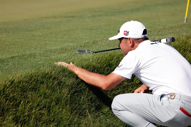 Gary Woodland lines up his putt the 15th green during the second round of the PGA Championship Friday in Kiawah Island.  Geoff Burke-USA TODAY Sports