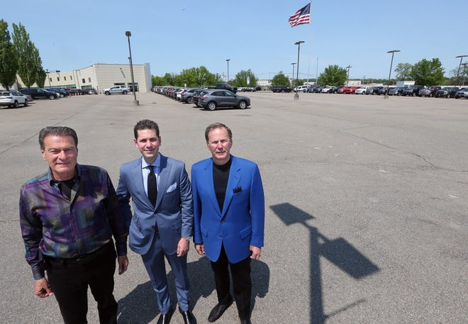 Bob Tasca Jr., Carl Tasca Jr. and Carl Tasca Sr. stand at the Tasca auto dealership on Pontiac Avenue in Cranston. Like many other auto dealers around the area, they are contending with a lack of inventory.