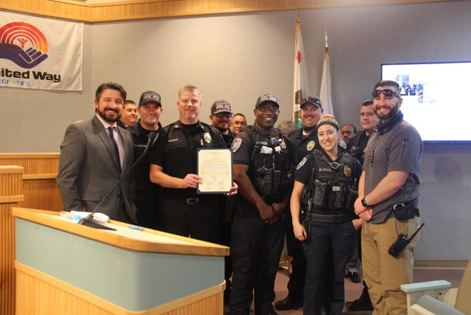 Members of the Ridgecrest City Council pose with members of the Ridgecrest Police Department at the council meeting May 19, 2021.