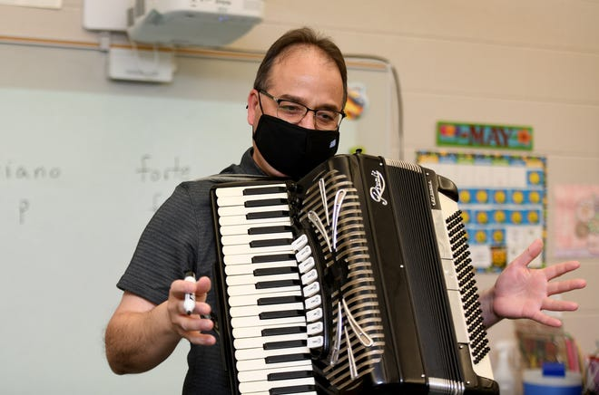 Alex Christ, who is retiring after 40 years at Northwest Local Schools, engages a second-grade class at Northwest Primary School with an accordion lesson.