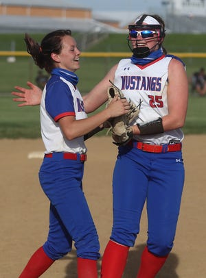 """Tuslaw's Brandie Cooper """"left"""" and Meredith Rankl celebrate defeating  Black River in this Division III district final at Norwayne High School Thursday, May 20, 2021."""