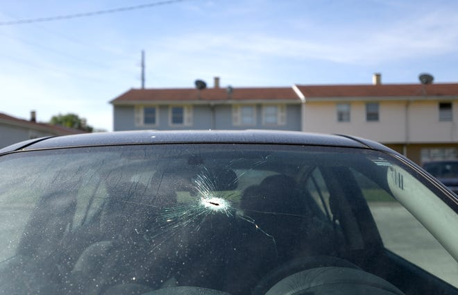 Bullet holes are left behind in buildings and cars at Gage Gardens, an SMHA-run facility in Canton, after two drive-by shootings.