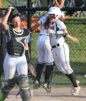Audrey Miller, of Marlington celebrates the winning run during their Division II district final at Hubbard on Thursday, May 20, 2021. Catcher Kailah Gregory of Hubbard walks off the field in the foreground.