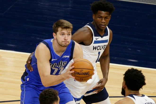 Dallas Mavericks guard Luka Doncic, left, is defended by Minnesota Timberwolves forward Anthony Edwards, right,  in the first quarter during an NBA basketball game on May 16 in Minneapolis.
