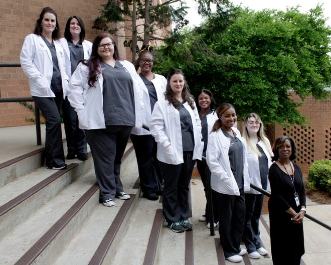 The Medical Assisting program held a pinning ceremony on Tuesday, May 11. Pictured top to bottom (front row) Torrie Watson, Haley Cumm, Brittany Woods, Samiya Rankins, Colette Hill (instructor), (back row) Jessica Davis, Markeela Foster, Kiaunya Crank and Emily Patterson.