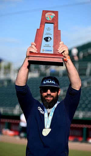 The Out-of-Door Academy head coach Mike Matthews celebrates their win over St. Johns Country Day in the 2A state baseball title game in Fort Myers, Thursday, May 20, 2021.(Photo/Chris Tilley)