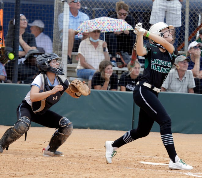 Cassidy McLellan of Lakewood Ranch High follows the flight of her second home run of the game against Miami Palmetto in the Class 7A state semifinal.