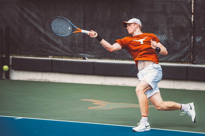 Freshman Micah Braswell returns a shot at this year's NCAA Division I Tennis Championships in Orlando. COUSTESY PHOTO