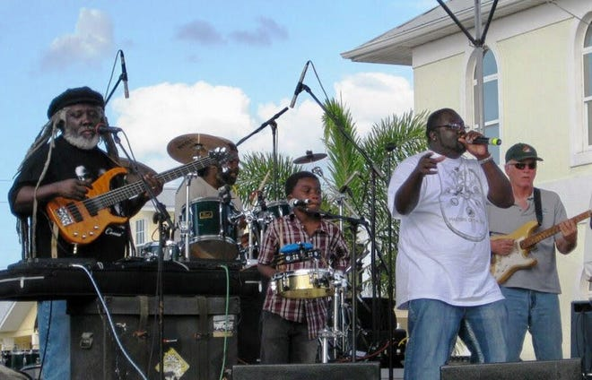 Oswald 'Ham' Caines, 61, performs with Democracy Reggae Band members, from left, Richie Benjamin, (drums), Joshua Thomas (congos), Damie Caines (lead vocals) and Richy Kicklighter (guitar). [PHOTO PROVIDED BY SHANTEL NORMAN]