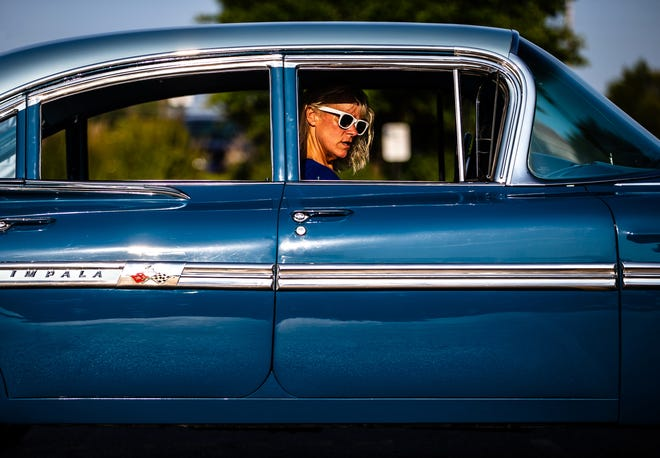 Shaun Stoutamyer (pictured) and her husband, Nick, will be back with their 1959 Chevrolet Impala at the International Route 66 Mother Road Festival in Springfield beginning Friday and running through Sunday. Nick Stoutamyer's grandfather, Lyn C. Bramlet, originally bought the car from Bates Chevrolet dealership in Springfield. The couple bought the car in 1994 and restored it in 2016.