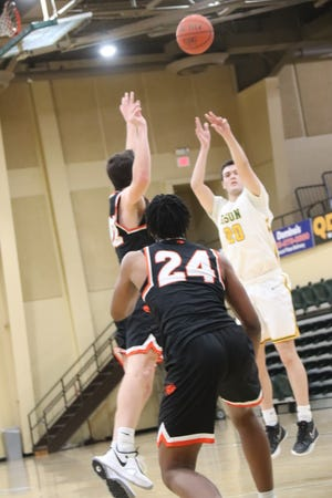 Harrison Stoddart (20) launches an outside shot during the 2020-21 season. Stoddart will be back as a second-year senior at OBU next season.
