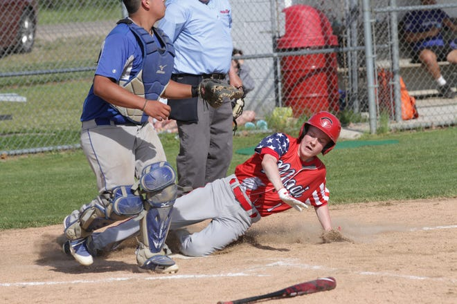 Kaleb Bissett of Colon slides safely into home plate to score the winning run for the Magi on Friday.
