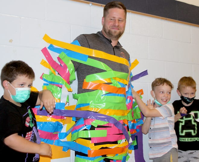 """Students at Wenzel Elementary in Sturgis duct-taped principalVincent Laporte to ta wall, a """"reward"""" for students giving their best effort on end-of-year testing."""