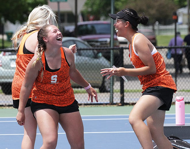 Sturgis' MacKenzie McMillin and Amy Chen celebrate after McMillin clinched the 18th point for Sturgis in regional action on Thursday. The 18th point automatically qualified the Lady Trojans for the Division 3 state finals.