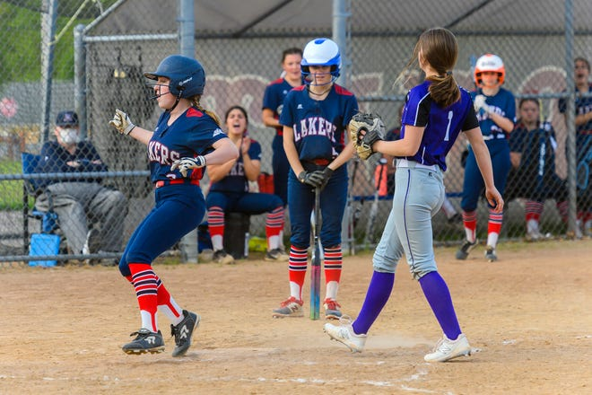 Apponequet's Sofia Estrella comes in to score on a passed ball last Wednesday during a 9-3 win over Bourne in South Coast Conference play. It was the season opener for Apponequet.