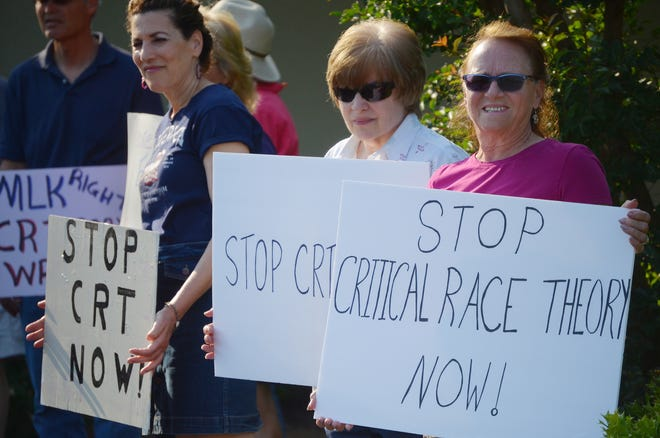 Protestors speak out against the implementation of Critical Race Theory during a demonstration outside of the Craven County Schools Administration Building on Thursday, May 20. [TODD WETHERINGTON / SUN JOURNAL STAFF]