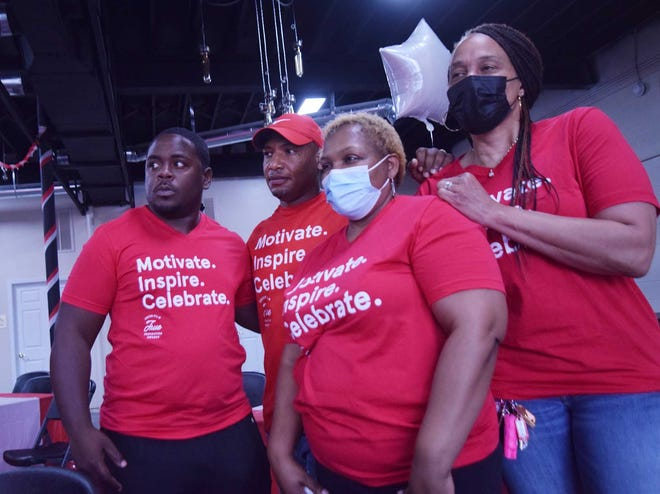 Corey Purdie, second from left, watched the Chick-fil-A True Inspirations live-stream awards Thursday night with friends and supporters Rodrick Pugh, Dardi Jarman and Tammie Dean.