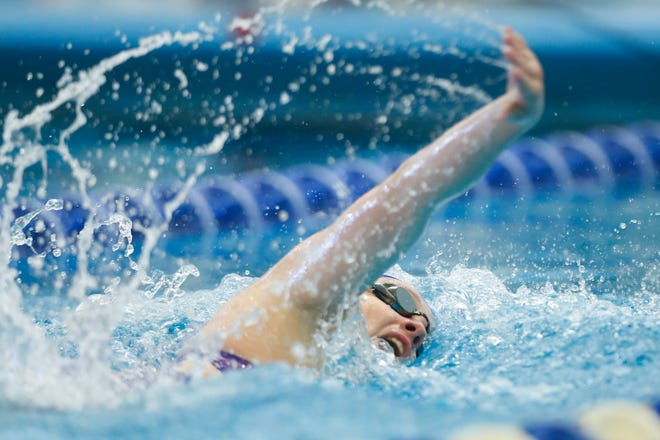 Washburn Rural's Mara Bare competes in the 200-yard freestyle at Friday's Class 6A State Swimming Championships at Capitol Federal Natatorium. Bare placed fourth with a time of 1 minute, 58.52 seconds, a season-best by nearly five seconds.