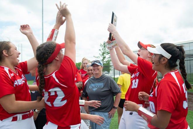 The Shawnee Heights T-Birds celebrate their 5A regional win over DeSoto on Friday at Washburn's Gahnstrom Field.