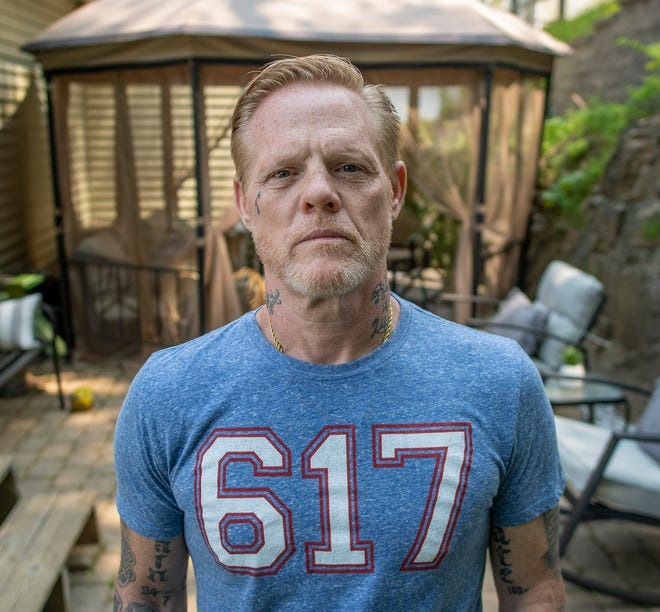 Sean Scott Hicks, shown here in his Worcester home, is looking to share his story through the mediums of music and television.