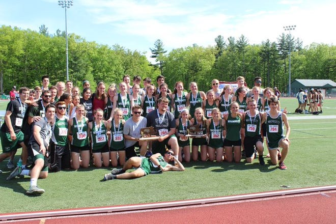The Wachusett Regional boys' and girls' track teams post with the hardware after capturing titles at the Central/Western Mass. championships in May 2019.