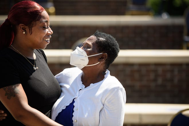 George Floyd's sister, Bridgett Floyd, left, hugs her stepmother Ruby Floyd at the conclusion of The George Floyd Memorial Foundation presentation on Friday, May 21, 2021 at Fayetteville State University. The foundation presented $25,000 to Fayetteville State University for the establishment of a scholarship that will bear George Floyd's name.