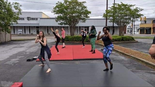 Members of the 'Survivor Girls' cast rehearsal for action scenes on Court Street in Gadsden.