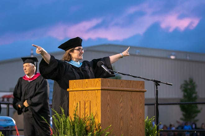 Southside High School Principal Lisa Miller directs the graduates to the exits at the closing of the 56th annual commencement ceremony at Jim Rowland Stadium on May 20, 2021. Miller is resigning after three years on the job.