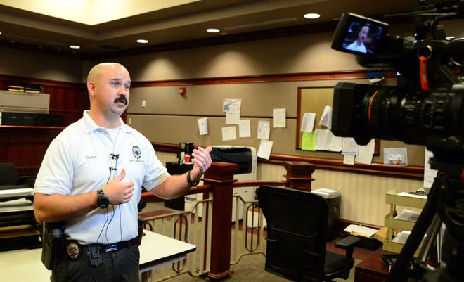 Tuscaloosa Police's Lt. Craig Parker speaks with the media on Friday, May 21, about legal products that have been associated with reports of overdoses in Alabama and other health concerns.
