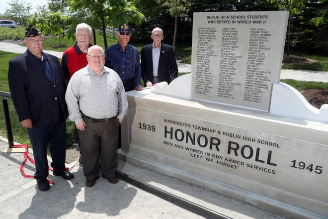 Rich Weber (center front) of the Dublin Historical Society and (from left) Jeff Noble, chair of the Dublin Veterans Committee; committee members Charles Krumholtz and Mack Parkhill; and Dublin Historical Society president Tom Holton on May 19 stand next to the newly installed Washington Township and Dublin High School Honor Roll monument memorializing local veterans who served in World War II. Weber's father, Charles Weber, and uncle, Louis Weber, are listed on the monument, which is at the Grounds of Remembrance at Dublin Veterans Park, 77 N. High St.