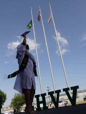 Nearly 350 Victor Valley High School seniors graduated during a drive-thru ceremony on campus in Victorville on Thursday, May 20, 2021.