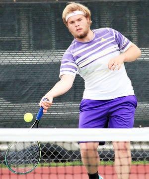 Watertown's Zandar Binde smacks a forehand return during a singles match Thursday during the state Class AA high school boys tennis tournament at Sioux Falls.