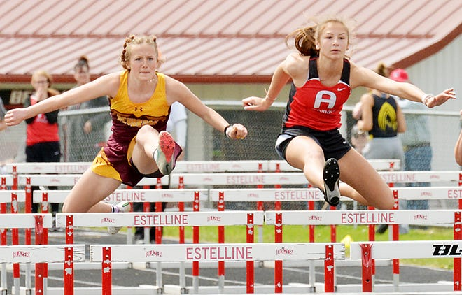 Catherine Klein of Deubrook Area (left) and Hadley Carlson of Arlington run in the girls' 100-meter hurdle prelims Thursday during the Region 3B high school track and field meet at Estelline. Carlson finished second and Klein fourth in the finals of the vent. Carlson also won the 300 hurdles and high jump.