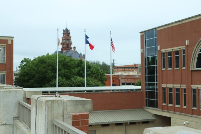 Foreground: Ellis County Courts & Administration Building. Background: Ellis County Historic Courthouse.