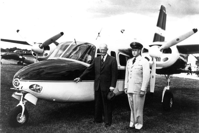 President Dwight Eisenhower stands next to the Aero Commander L-26 that he used as Air Force One in this 1955 photo. The aircraft will be on display Saturday, June 5, at Mid-Way Regional Airport.
