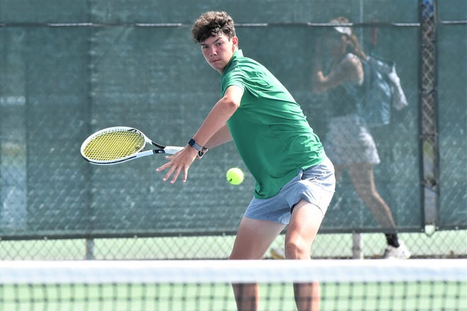 Wall's Payne Smith goes for a shot at the net during Friday's Class 3A boys singles final of the UIL state championships at the Blossom Tennis Center in San Antonio on May 21, 2021.