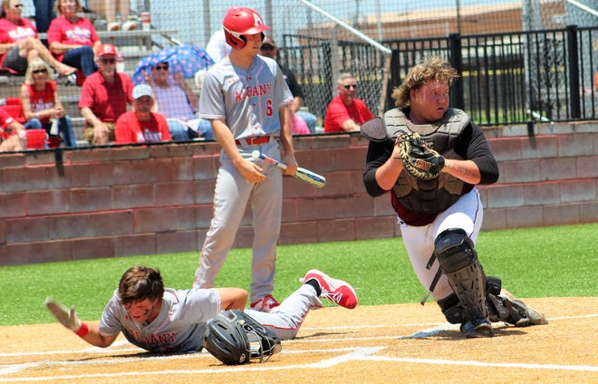 Albany's William Webb is out at home after Hawley catcher Kolter Willeford makes the play and checks other Lions baserunners in the first inning of Friday's Class 2A playoff game at Abilene High. The Lions got two runs across in the inning and went on to win the series opener, 4-0.