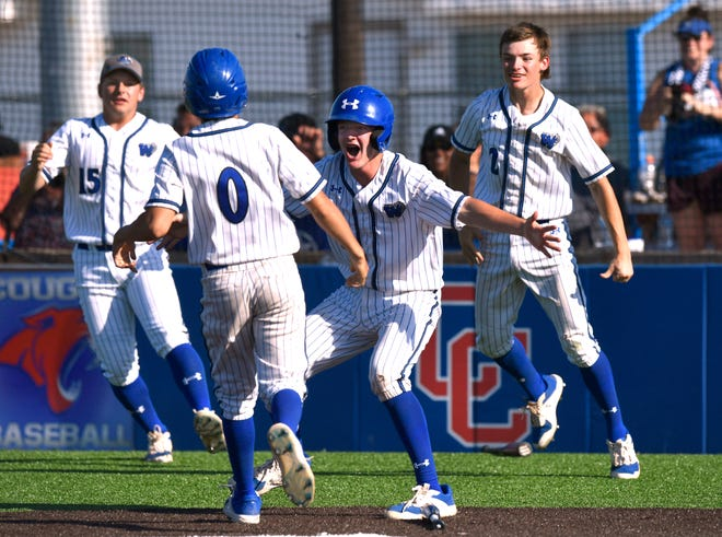 Westbrook's Jeremiah Ramirez is welcomed after scoring the winning run in extra innings against Baird in the opener of the Region I-1A semifinal series at Cooper High School in Abilene. Westbrook won the series 2-0.