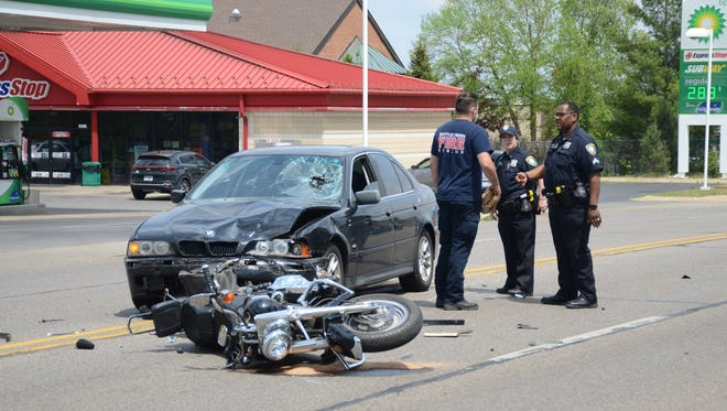 A motorcyclist was injured when he pulled into the path of a car on Beckley Road Thursday afternoon.  (Trace Christenson/The Enquirer)