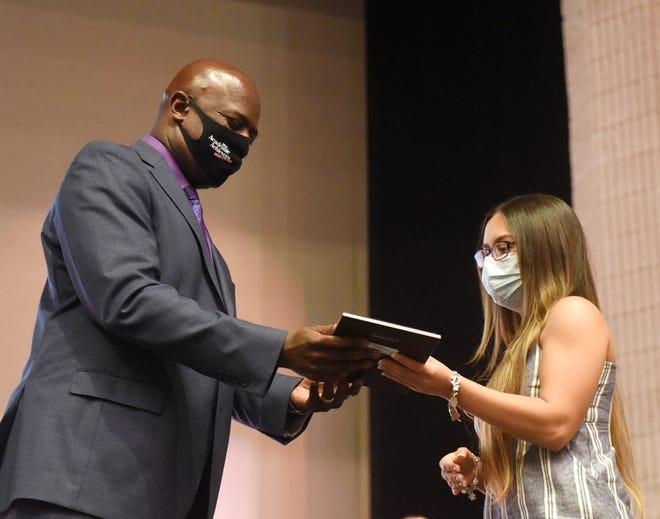 Miller High School principal Bruce Wilson hands an award to Diamond Benavidez Barrera during the Academic Achievers Ceremony, Thursday, May 20, 2021, at Selena Auditorium. Benavidez Barrera plans to attend the University of Texas to study petroleum engineering.