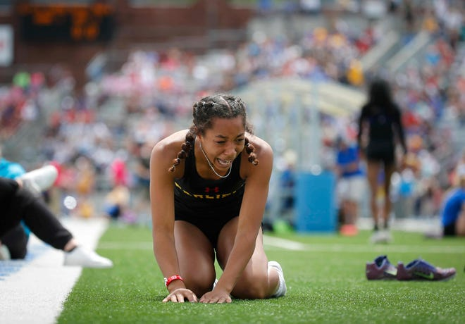 Carlisle's Isabelle Noring succumbs to her emotions after winning a long jump title in Class 3A during the 2021 Iowa high school state track meet at Drake Stadium in Des Moines on Friday, May 21, 2021.