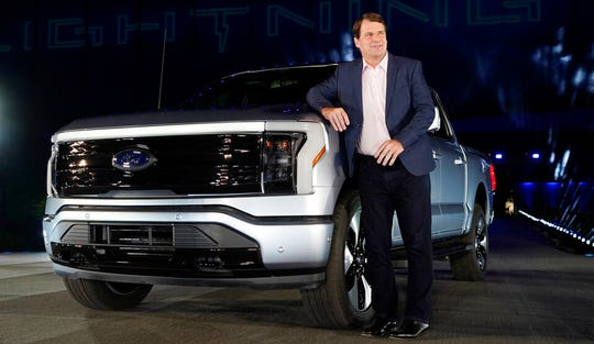 Jim Farley, Ford Motor Company's chief executive officer, stands next to the company's new Ford F-150 Lightning, Wednesday, May 19, 2021, in Dearborn, Mich.