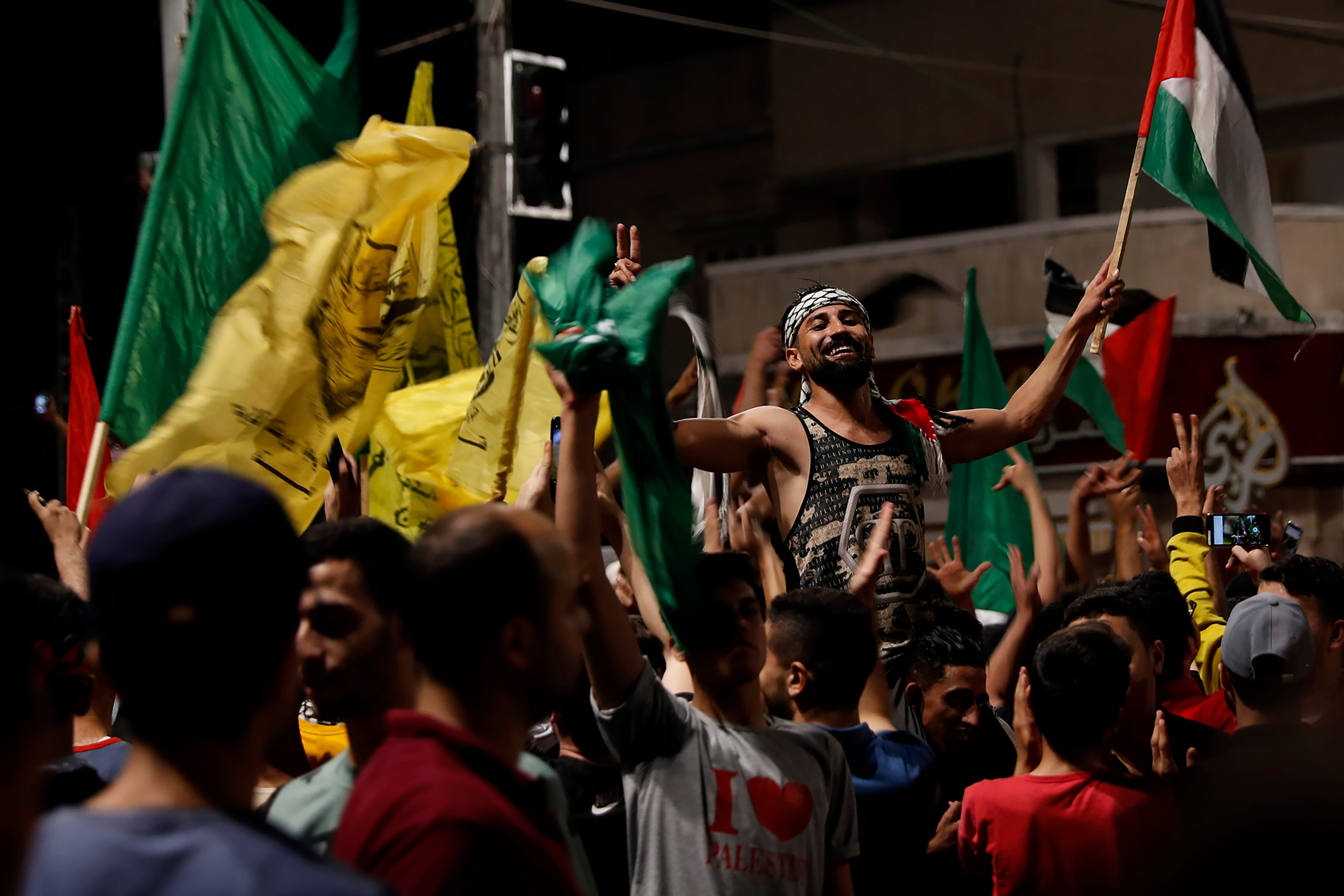 Palestinians see victory in Gaza truce as Israel warns Hamas 2
