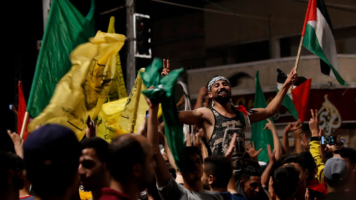 Palestinians see victory in Gaza truce as Israel warns Hamas 3