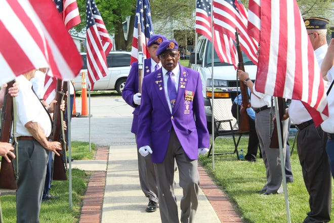 Members of the Military Order of the Purple Heart Color Guard appeared at Gibsonburg's Purple Heart Village dedication ceremony Thursday at Williams Park. The village is the first Sandusky County community to be awarded the designation.