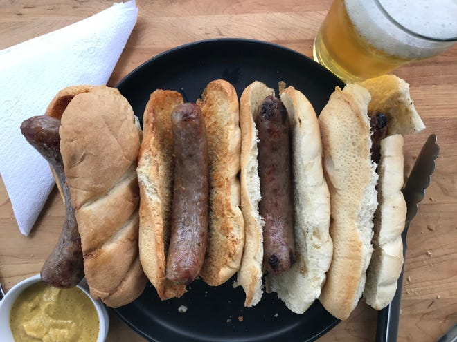 Bratwurst done in an air fryer, left, had as much snap and brat flavor as those that were grilled, right, during tests.