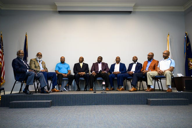 Current and former law enforcement officers gather to discuss relationships between law enforcement and Black communities during a forum at the Mauldin Cultural Center Thursday, May 20, 2021.