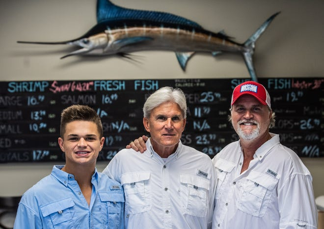 Parker Wiser, 20, left, Henry Massler, 68, and Rob Caldwell, 53, co-owners of The Morning Catch opened a new seafood and meat market in Jackson, Tennessee on May 5, 2021. They hope to provide the community of Jackson with fresh seafood and expand the business to other locations.