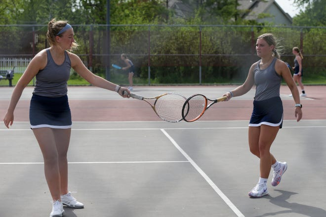 Central Catholic's Annabelle Brouillette and Mayah Love tap rackets after a point during an IHSAA sectional tennis doubles match, Thursday, May 20, 2021 in West Lafayette.